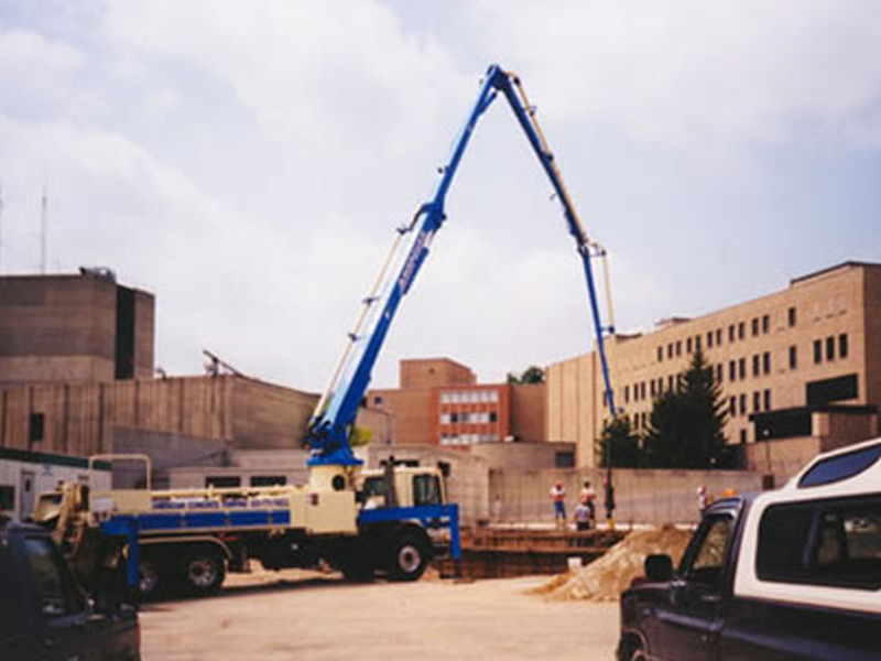Reid Hospital building addition construction scene with a concrete truck